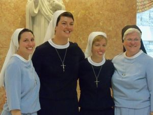 Sr. Kathryn Teresa (second from the left) was received into the novitiate on August 13th!